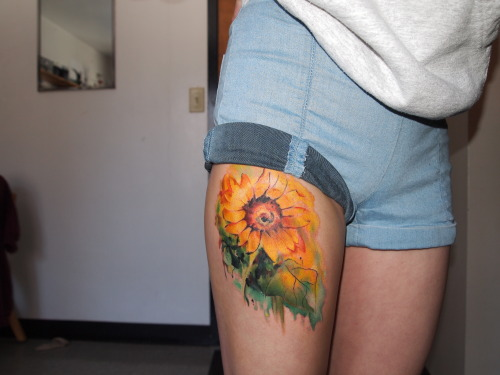 fuckyeahtattoos:  This is my new watercolor sunflower tattoo. Watercolor technique is not about perfection. When you see it up close it looks slightly messy and unclear but when you see the whole picture from a distance it suddenly becomes clear.