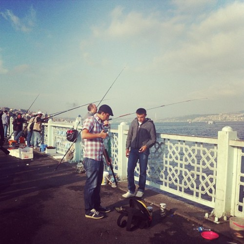Men fishing along Galata bridge. #istanbul #turkey #iphonesia #instagramer
