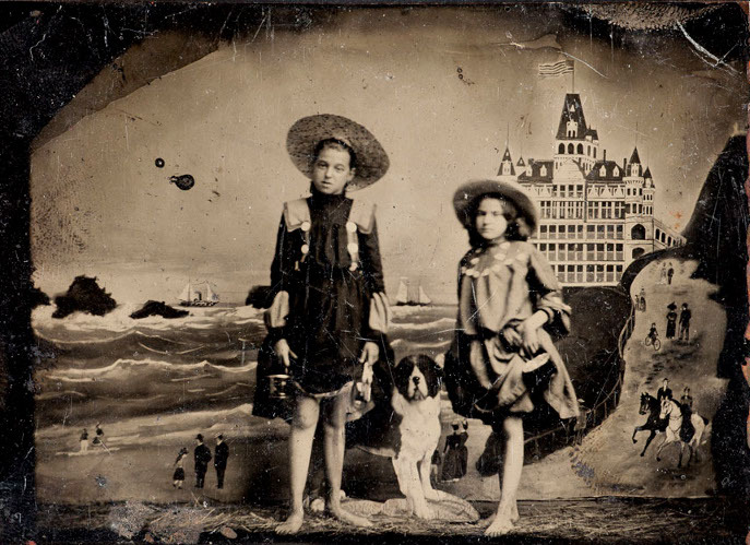 tintype photographic portrait of two girls posing in front of a painted background of the original Cliff House in San Francisco c.1900 photographer unknown