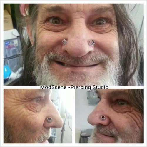 "professorxvx:  freemindfreebody:  xgodiswarx:  Nostril piercings helping him to breathe after 15 years of not breathing properly through his nose At 60 years of age, this professional sculptor and artisan has already lived a colourful life. After a severe motorcycle accident, he required reconstructive surgery to his face; the following years of failed nasal repair surgeries and a broken nose from his rowdy political activism left this man with a large amount of scar tissue within his nose - his septum had all but 'collapsed'. This prominent scar tissue blocked a significant amount of his lower nasal passage and left him unable to breathe through his nose. He has spent the past 15 years struggling with breathing, sleep apnea, heavy exercise or strenuous activities, and even eating.After consulting many doctors and being told that there was simply ""nothing [they] could do"", he came to us with the idea of bypassing the collapsed passage by creating a hole either side of his nose which would be large enough for him to breathe through. While large-gauge nostril piercings are nothing new to body modification enthusiasts, the idea that this piercing could be functional and so practical in this particular case was a very interesting prospect.  This is so cool!  Love this."