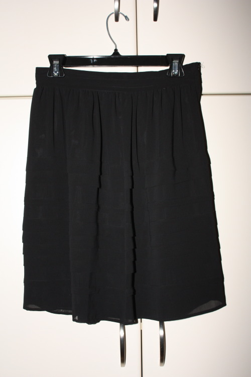 $25.00 Black chiffon knee length pleated skirt by MGCSPLLS