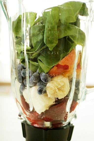 e-d-i-b-l-e:  Green Monster Smoothie | Recipe from Sing For Your Supper Blog Ingredients: 1 banana, roughly chopped  4 or 5 strawberries  1/2 cup fresh blueberries  1 small peach, peeled and roughly chopped  1 heaping cup (or more) fresh spinach leaves, thoroughly rinsed  splash vanilla soy milk  1 tablespoon Greek yogurt  2 teaspoons honey  1/2 cup crushed ice  Method: Place all ingredients in a blender and blend until smooth.  Serve immediately.