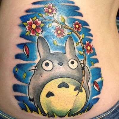 fuckyeahtattoos:  My Neighbor Totoro, my first tattoo by my wonderful tattoo artist in Cutler Ridge, Florida named William Quiceno. I love Ghibli studios/Miyazaki films, and My Neighbor Totoro is one of my three favorites and means a lot to me and represents a lot from my childhood. I can't wait to have more done.