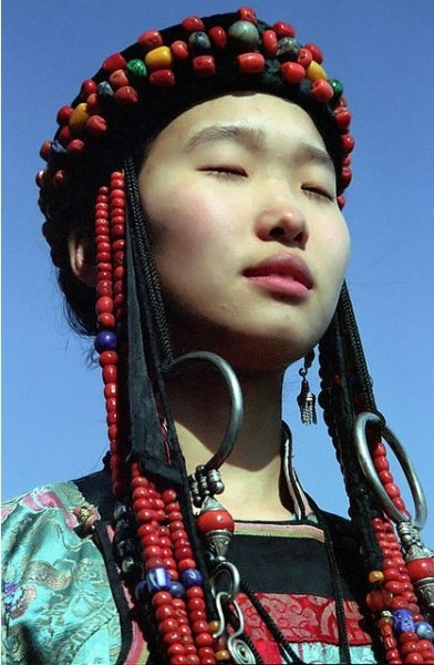 jaguarsvisionboard:  Young Buryat girl in traditional dress | Lake Baikal | Buryatia, Russia | by Pavel Ageychenko