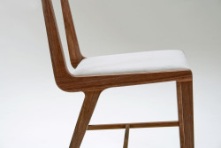 The Carli Chair is a lightweight, low footprint dining chair that draws aesthetic influences from Italian furniture designer Carlo de Carli. First shown at Toronto's Interior Design Show 2012, this hand crafted chair has been shown at furniture exhibitions at the Ontario Crafts Council and Propellor galleries. Our latest version, featuring rich walnut and custom upholstery will be shown at IDS 13 in the 10th annual prototype exhibition.
