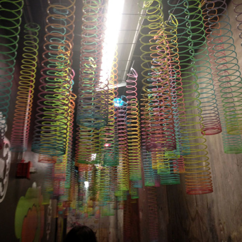 Stylish slinky toys hang from the ceiling at the L'Amour by Nanette Lepore for JCP launch party. Photographed by Julia Rubin.