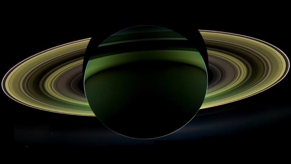 wolfmank:   This rare view of Saturn is among the most awe-inspiring images of the planet we've ever seen Robert T. Gonzalez, io9.com Stop what you're doing and look at this. Banded, backlit and beautiful, this verdant view of Saturn — just released by CICLOPS — is one of the most remarkable images of the planet ever captured by NASA's Cassini spacecraft. And trust us, that's…  Surreal…  Amazing on so many levels.