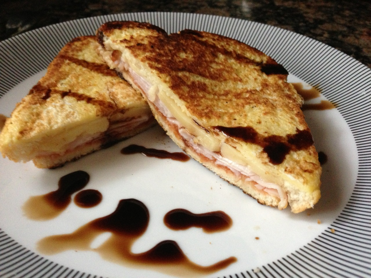 My bastardized Monte Cristo with gruyere, tomato jam, smoke turkey topped with maple balsamic vinegar. -Gastrodamus