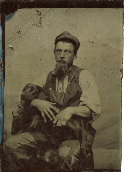 ca. 1860-80's, [tintype portrait of a disheveled looking man with his black lab] via Ebay