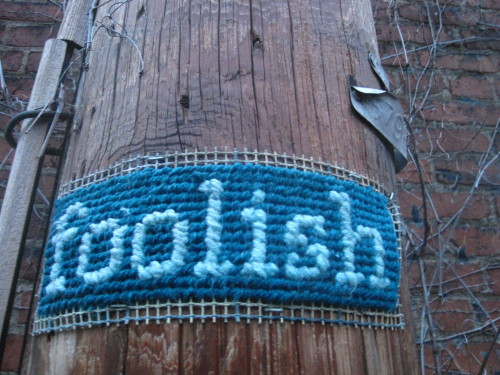 "GPOY pittsburghisbeautiful:  ""Foolish"" cross-stitch in an alley in Bloomfield."