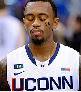 UCONN basketball player Ryan Boatright observes a moment of silence for Sandy Hook elementary school before last night's game.