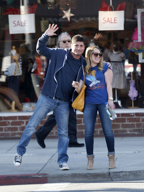 Hilary Duff adorably deals with some random dude that wants to photobomb her.