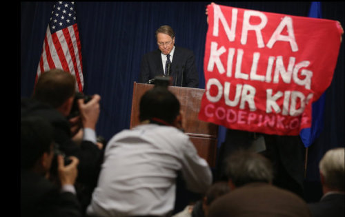 "inothernews:  NRA, GTFO   A demonstrator held up a banner as Wayne LaPierre, executive vice president of the National Rifle Association, delivered a statement in Washington on Friday. (Photo: Chip Somodevilla / Getty Images via The New York Times) I'm sincerely asking my followers to reblog the shit out of this photo.  From what I am told by social media, I'm glad I didn't watch this NRA insanity. Bunchafuckingoofs think anyone but them gives a shit ""what gun owners want.""  Team Code Pink Hold That Sign Up Till Your Arms Are Numb"
