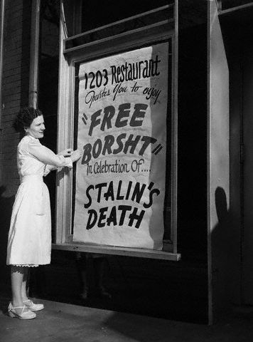 "floriental:  a waitress at the 1203 Restaurant, puts up a sign outside the restaurant, March 6, inviting everyone to enjoy ""Free Borsht"" in celebration of Stalin's death. 1953."