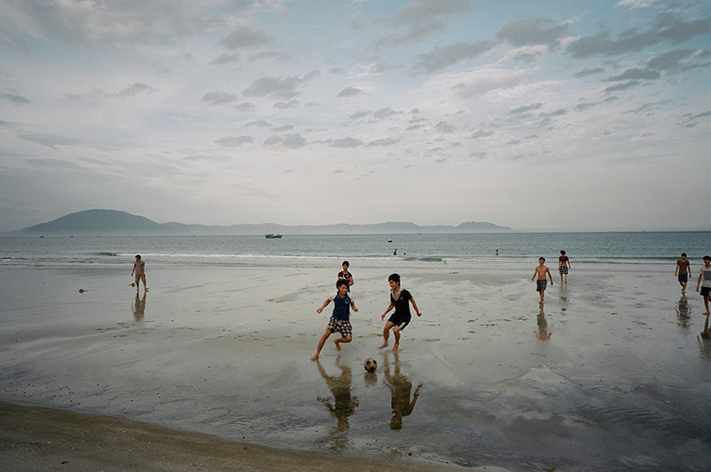 Near Ninh Hoa, Vietnam. August, 2012.  Playing soccer by the South China Sea.