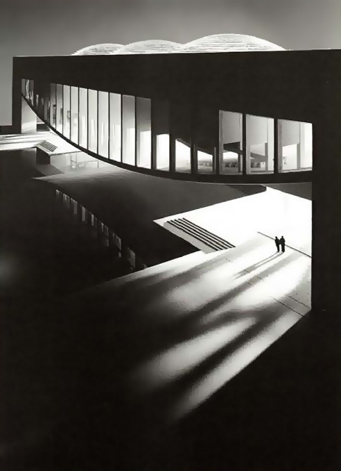 "onsomething:    onsomething    Louis I. Kahn | Palazzo dei Congressi, 1968 Venice The initial program called for a meeting hall to hold 2,500 to 3,000 persons; ""a site of encounter"" in Kahn's words. Kahn responded vigorously to the site, conceiving a reinforced concrete structure hung like a bridge and offering views of Venice and the lagoon from openings in its roof. Referring to St. Mark's Basilica in the distance, Kahn proposed covering the three domes with lead. ""I was constantly asking each building I love so much in Venice whether they would accept me in their company."" In 1972, out of concern for the overcrowding of the gardens, an alternative site was selected for the project in the shipbuilding district of the Arsenale. Here the Congress Hall design became a true bridge, its pairs of rectangular piers set on either side of an inlet of the canal. Via 1"
