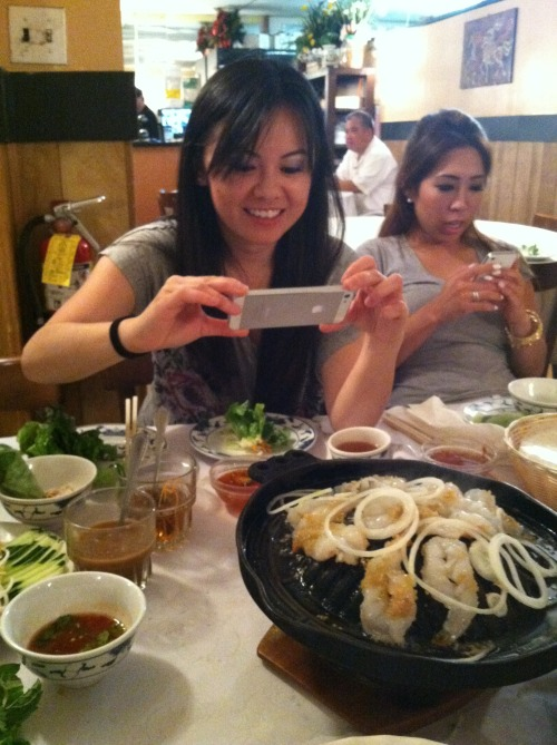TL taking a photo of the shrimp at Anh Hoang 7 course beef place in SF