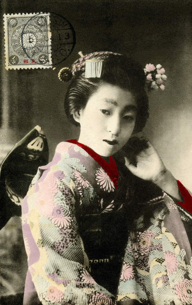 "Osaka Maiko with a Butterfly Obi 1913 (by Blue Ruin1) ""In Osaka there are pastime houses called the ochaya, which are the tea-houses literally, but entirely different from those in Tokyo. If you want to engage a geiko [geisha], first you have to go and give order to one of the ochaya, then the ochaya makes announcement to the misĕ, or the office of the geiko guild (equal to the Kemban in Tokyo), and the office despatches a man or maid-servant to the girl's house, which is called the yakata…"" From ""The Nightside of Japan"" by T. Fujimoto, first published in 1914"
