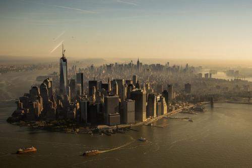 inothernews:  The spire for the top of One World Trade Center was hoisted into place at the top of the building in New York Friday, bringing the building to a symbolic 1,776 feet above ground. (Photo: Gary He / EPA via The Wall Street Journal)