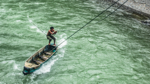 Man and boat, Bukit Lawang, Indonesia. thefreshsite.com