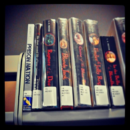 "Prison Nation, on the shelves at the public library I grew up ""living"" in! This sight sure made me smile."