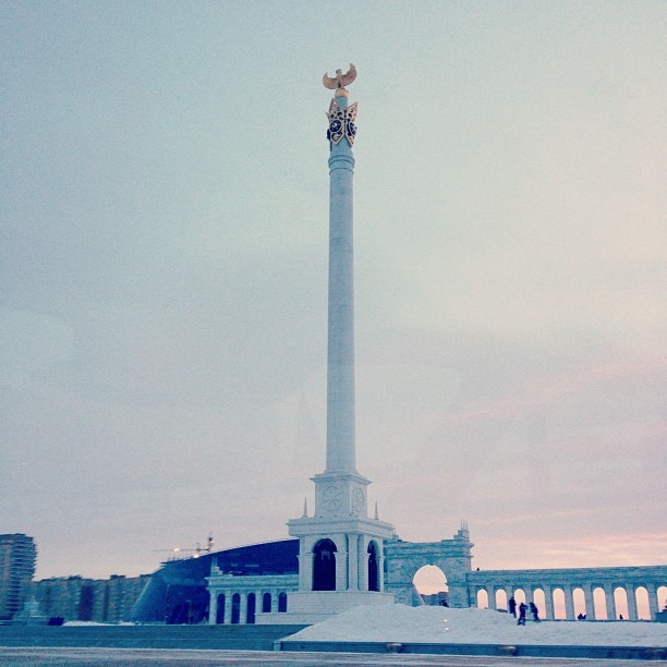 instagram:  Astana (Астана), Kazakhstan's Capital City  For more photos from Kazakhstan's capital city, check out the #astana and #Астана hashtags along with the location pages for Bayterek, Khan Shatyr, and the Palace of Peace and Reconciliation.  Along the Ishim River in the center of a vast steppe lies Kazakhstan's capital city, Astana (Астана). Though a functional city since 1830, Astana only became the nation's capital in 1997. The past 16 years have brought significant architectural developments, many of which display innovative designs to functionally cope with the city's drastic temperature fluctuations and symbolically reflect traditional Kazakh culture. And where there's been architectural innovation, there have been numerous Kazakh Instagrammers to share these wonders with the world.  The city's main landmark, a 105-meter (344-foot) tall observation tower called Bayterek (Бәйтерек), evokes a Kazakh folktale about a bird that laid a golden egg in the tree of life. Astana also boasts a large pyramid structure, The Palace of Peace and Reconciliation (Бейбітшілік пен келісім сарайы), built to house space for diverse world religions, a full opera house and a natural history museum beneath the stained-glass doves that adorn its glass apex.  One of the city's newest additions is the Khan Shatyr entertainment center, a series of parks, shops and sites of diversion spanning 140,000 square meters (35 acres) that is covered by the world's largest tent. The transparent material allows sunlight in while simultaneously maintaining a stable temperature throughout the year.