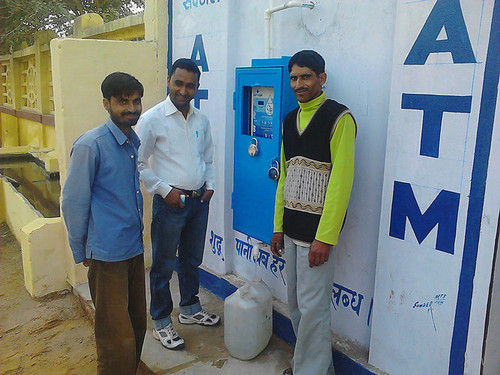 "Anand Shah's company Sarvajal is working to bring clean water to India. But it's not just giving it away. Instead, it's Each of these franchisees sets up ""water ATMs,"" where rural Indians can go and see their water being purified and bottled."
