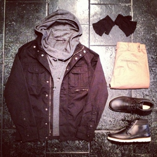 "BleeckerSt.com Men's Outfit of the Day ""Hoodlum""  Army Shirt Jacket Black: http://www.bleeckerst.com/collections/mens-jackets Wool Drawstring Sweater: http://www.bleeckerst.com/collections/mens-sweaters-and-knitwear Romare Hi Black: http://www.bleeckerst.com/collections/kicks Skinny Khaki Chino: http://www.bleeckerst.com/collections/mens-jeans-and-pants Black Fingerless Gloves: http://www.bleeckerst.com/collections/accessories-1"