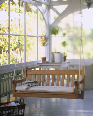 soft sunroom with a swing