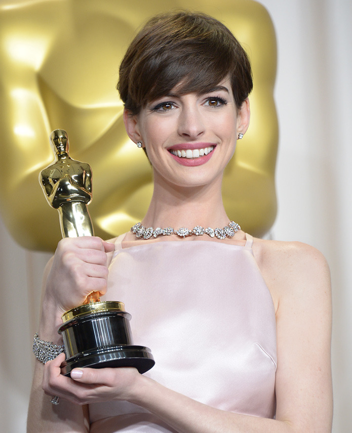 Best Supporting Actress winner Anne Hathaway made a glamorous statement at tonight's Academy Awards® in a Tiffany diamond necklace from the 2013 Blue Book Collection, Lucida® earrings and diamond bracelets.
