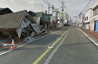 Google Street View Captures Fukushima Ghost Town Via The New York Times:  The eerily empty streets of Namie, a town deep in the evacuation zone around the crippled Fukushima Daiichi nuclear power plant, are featured in the latest images captured by Google for its Street View mapping project. The scene is wrenching: houses flattened by the earthquake and now abandoned for fear of radiation; rows of empty shutters on a boulevard that once hosted Namie's annual autumn festival; ships and debris that still dot a landscape laid bare by the 50-foot waves that destroyed its coastline more than two years ago. Namie's 21,000 residents are still in government-mandated exile, scattered throughout Fukushima and across Japan. They are allowed brief visits no more than once a month to check on their homes.  Over at Lat Long, the Google Maps blog, Tamotsu Baba, the town's mayor, writes:  Ever since the March disaster, the rest of the world has been moving forward, and many places in Japan have started recovering. But in Namie-machi time stands still. With the lingering nuclear hazard, we have only been able to do cursory work for two whole years. We would greatly appreciate it if you viewed this Street View imagery to understand the current state of Namie-machi and the tremendous gravity of the situation. Those of us in the older generation feel that we received this town from our forebearers, and we feel great pain that we cannot pass it down to our children. It has become our generation's duty to make sure future generations understand the city's history and culture—maybe even those who will not remember the Fukushima nuclear accident. We want this Street View imagery to become a permanent record of what happened to Namie-machi in the earthquake, tsunami, and nuclear disaster.  Image: Screenshot, Google Street View from Namie-machi, Fukushima, Japan.
