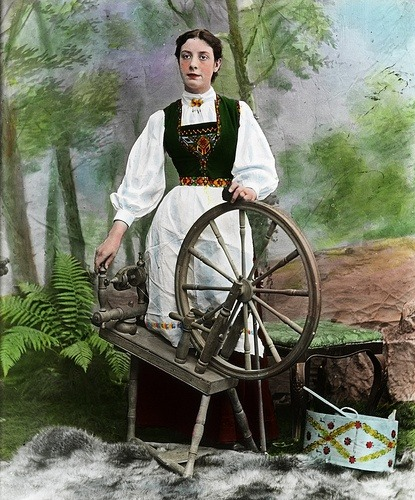 folkthings:  Woman and spinning wheel by Fylkesarkivet i Sogn og Fjordane on Flickr