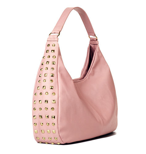 "mark Total Studs Bag  Click to visit my AVON/mark store!     Call it a tough cookie-this bag mixes pearlized-pink faux leather with edgy studs all along its sides. Shiny goldtone hardware and studs. 3 interior pockets: 1 zippered pocket at front, 2 slip pockets at back. 10"" H x 18"" W x 4"" D (11"" handle drop)"