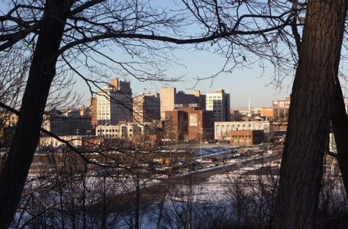 "The Atlantic Cities:  ""Defending Youngstown: One City's Struggle to Shrink and Flourish Daniel Denvir. Jan 31, 2013. Progress is measured by the bulldozer's pace in Youngstown. The hobbled Ohio steel giant has lost more than 100,000 residents since the 1950s and has been racing to tear down the now dilapidated homes jobless workers left behind. The city has demolished at least 2,566 structures since January 2006 and is constantly seeking new funds—from the stimulus, from the multi-billion dollar state attorneys general settlement with misbehaving mortgage servicers, and now, perhaps, from leasing the city's land for natural gas drilling, or fracking—to knock down more. Many homes, however, fall to arson first. It is a way to cash in on insurance, or for scrappers to steal copper wiring and plumbing. Or, sometimes, it's just the pyromaniac ennui born of unemployment and nihilism. ""We have guys,"" says local activist Phil Kidd, my guide through the city's pockmarked streets, ""who are caught and say, 'I like watching houses burn; I like the lawlessness of it. I wanted to see how long I could get away with it."" Firefighters have even suggested that neighbors might set some ablaze, eager to see a long-decaying vacant structure prioritized for demolition. Arsonists torched 158 houses in 2005 alone.  Transforming this decaying tableau was at the heart of an ambitious plan called Youngstown 2010, implemented in 2005, set to retrofit a city built for more than 200,000 for the much smaller city of today. In a sober inversion of traditional civic boosterism, city leaders and community organizers set their sights on small. Kidd imagines a more ecologically in-tune metropolis, a ""rurban"" post-industrial city interspersing large-scale urban farms and forest amid neighborhoods targeted for density. Knocking down the blight must come first."" Photo: Sean Posey"