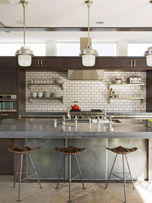 justthedesign:  Modern Industrial Kitchen Designed by Randy Weinstein Design  Love the open shelves against the subway tile backsplash. The double faucets over the sink is a unique touch.