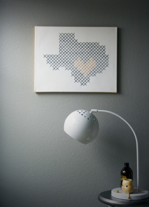 scissorsandthread:  Giant Cross Stitch Wall Art | Whimseybox As a cross stitch fanatic, this is one of the most exciting projects I've seen in ages! When I've seen this kind of thing done before, it's usually with wood, but this is made using a stretched canvas with holes punched through, meaning it's going to be so much easier to hang! Whimseybox suggests that if you have something in mind to stitch but you're not sure how to do it, search '8 bit' on google images. So fun!