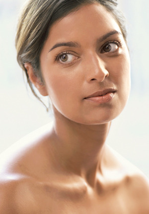 "Why does Jhumpa Lahiri look naked—or, at the very least least, topless—in her author photo, the one featured alongside a MUCH smaller picture of her book, The Namesake, in GQ's list of ""The 21 Books From the 21st Century Every Man Should Read.""Lahiri is included with other writers such as Jonathan Lethem, Jonathan Franzen, George Saunders and Junot Diaz. Any one of them might have a clavicle as pretty as Lahiri's, but we wouldn't know. These men are portrayed in black ink drawings, ostensibly fully clothed. Lahiri, the 21st of the 21 authors included on the list, is the only one who appears so… undressed.I'm not sure what to make of this. I'd be a prude if I said the picture of Lahiri was inappropriate. It's tasteful. She looks stunning. It's not as if there's any cleavage, just the aforementioned clavicle and her smooth, glistening skin. So why am I so put off by this? Because I feel like she's using her ""pretty"" to gain publicity and attract an audience. Because I think the quality of someone's writing should have nothing to do with his or her appearance. Because I think Lahiri should pretend her looks are incidental to her success, and this picture suggests otherwise. Because I don't want to question my own success (miniscule compared to Lahiri's, but still), and consider the role my appearance has played."