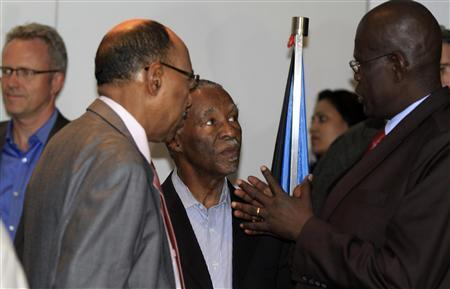 "PICTURED ABOVE: Sudanese Defence Minister Abdelrahim Mohamed Hussein (L) talks to his South Sudan counterpart John Kong Nyuon (R), with former South African President Thabo Mbeki (C) in Ethiopia's capital Addis Ababa, March 8, 2013.  Sudan, South Sudan to withdraw forces from buffer zone  Sudan and South Sudan agreed on Friday to order their forces out of a demilitarized border zone within a week, a mediator said, possibly opening the way to the resumption of oil exports from the south. South Sudan seceded from the north in 2011 after decades of war but border disputes and disagreements over oil pipeline fees have dragged on, delaying much-needed economic development. The landlocked South shut down its oil production of 350,000 barrels per day more than a year ago during a row over how much it should pay the north to pipe its crude to a coastal terminal for export. With oil the lifeline of both economies, the move has strained their state budgets, weakened currencies, stoked inflation and worsened economic hardship. Defense ministers from both sides met on Friday for a new round of talks in Addis Ababa to set up a buffer zone along their frontier. Former South African President Thabo Mbeki, who chairs an African Union mediation panel, said the two had agreed to order their forces out of the demilitarized zone by March 14. ""D-day is March 10. The agreement calls for immediate orders(for withdrawal) to be issued within d-day plus four days,"" he told a news conference in the Ethiopian capital. The two countries will finish withdrawing their troops from the demilitarized zone by April 5, according to a timetable agreed by both sides seen by Reuters. The former civil war foes have made a number of agreements about border security in the past, but have failed to implement them. After teetering on the brink of full-scale conflict in April with the worst border clashes since their split, the two countries agreed in September to set up a buffer zone, which could defuse tensions enough for the South to resume oil output. But neither side had pulled its army back from the almost 2,000-km (1,200-mile) border due to the mistrust left over from one of Africa's longest civil wars. Friday's talks were the first in nearly two months. Two meetings between Sudan's President Omar Hassan al-Bashir and South Sudan's Salva Kiir in Addis Ababa in January failed to break the stalemate. Animosity runs high between Bashir's government in Khartoum and his former foes up the Nile in Juba. Nearly 2 million people died in the north-south civil war, which left South Sudan economically devastated and awash with guns. Khartoum accuses Juba of backing rebels of the Sudan People's Liberation Movement-North (SPLM-North) in South Kordofan and Blue Nile, two Sudan states bordering the South. The SPLM-North, made up of fighters who sided with the South during the civil war, controls part of the Sudan side of the border, which complicates setting up the buffer zone. South Sudan has denied supporting the rebels."