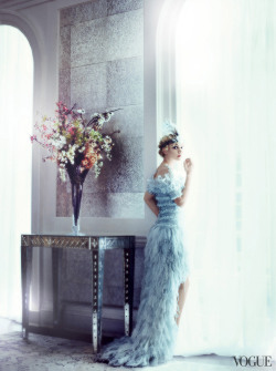 vogue:  Carey Mulligan in Chanel Haute Couture chiffon, feather, and tulle dress with flouncing open shoulders. Twenties headband from New York Vintage. Photographed by Mario Testino See the slideshow