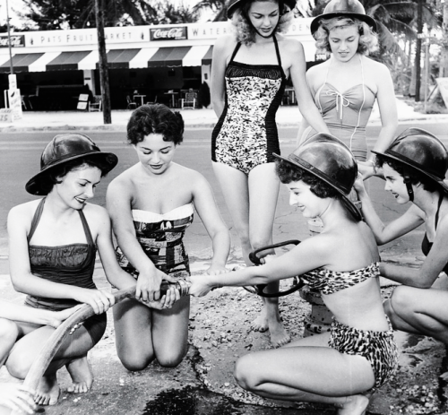 vintagegal:   Pin-up models at the Miami Fire College, photo by Bunny Yeager, 1955