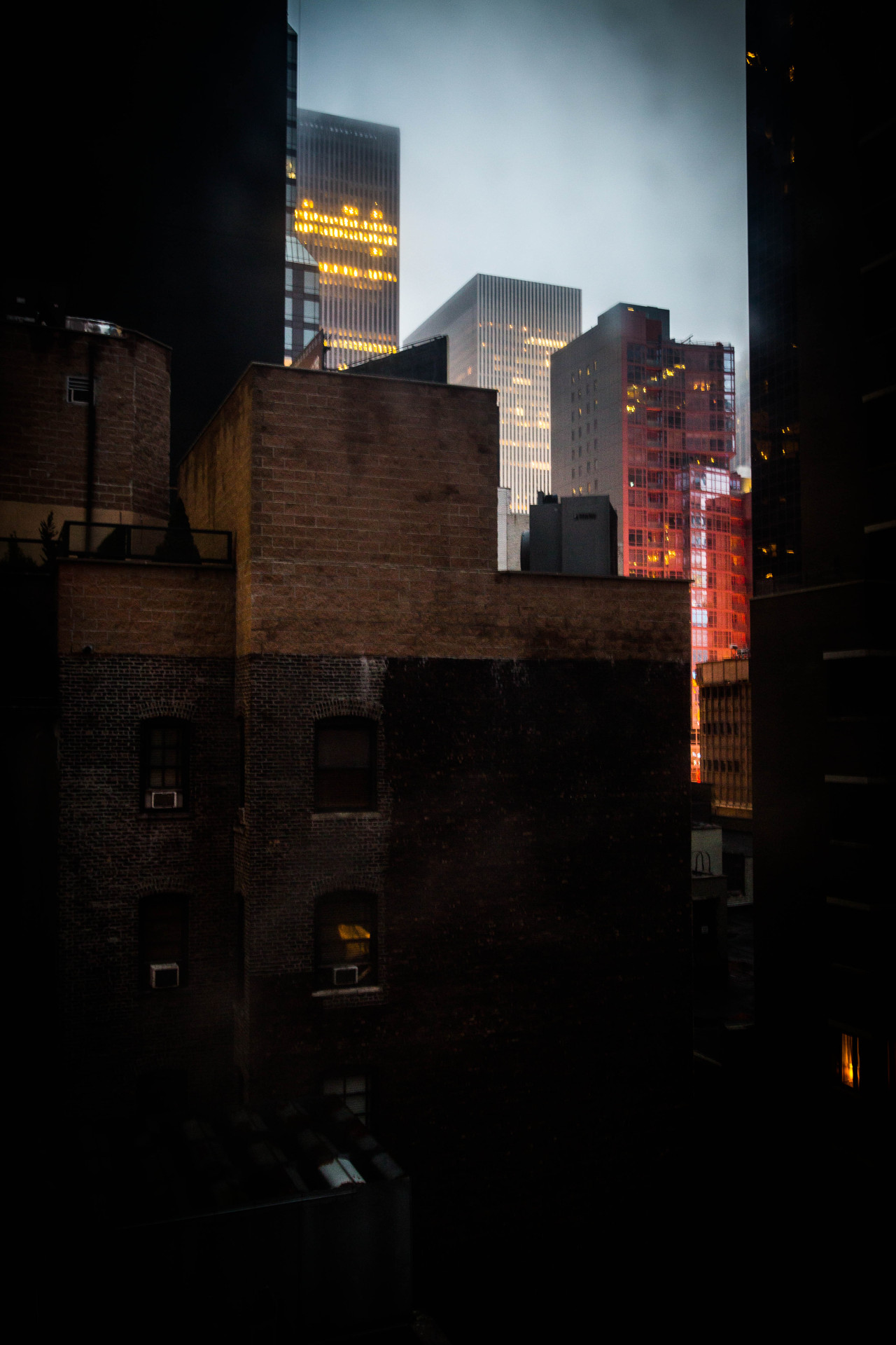Rear Window #2: the lights at dawn of Times Square. West 50th Street, New York City.