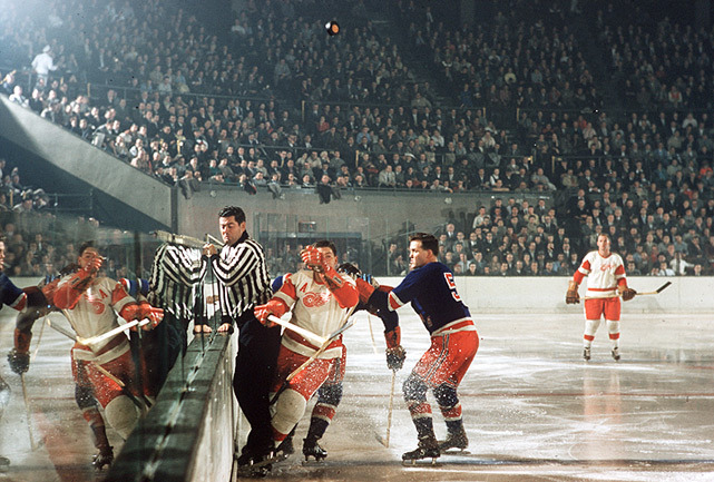 SI photographer Hy Peskin with a rare color picture of the NHL is 1957 as the Red Wings and Rangers square off. (Hy Peskin/SI)