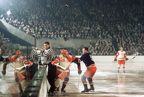 siphotos:  SI photographer Hy Peskin with a rare color picture of the NHL is 1957 as the Red Wings and Rangers square off. (Hy Peskin/SI)  These old hockey photos are amazing.