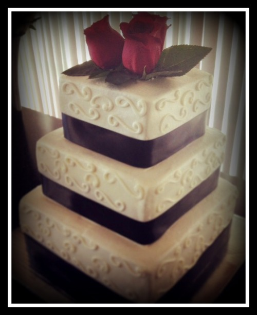 This is a very simple, traditional wedding cake that I did last weekend.  The bottom tier is white cake with a strawberry filling.  The middle tier is a chocolate cake with a ganache filling. And the top tier is red velvet with, of course, cream cheese filling.  All great flavor choices!  :-)