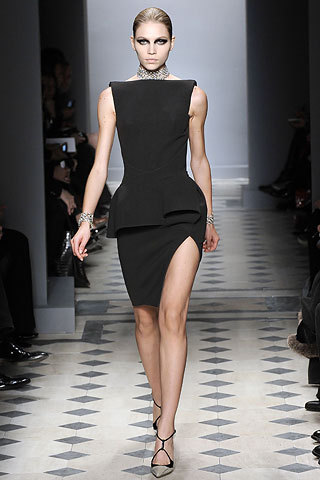 Nicolas Ghesquière's dramatic piece makes a bold statement with its slit in a symmetric sac dress.