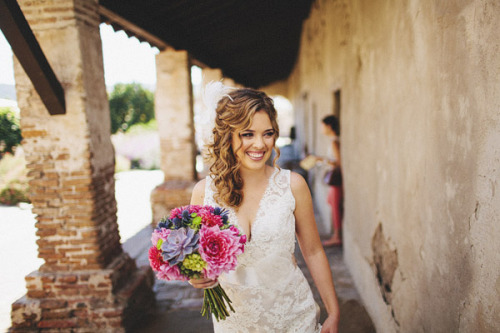 Flawless hair, a stunning lace dress and beautiful colors in a bouquet make this a perfect photo!
