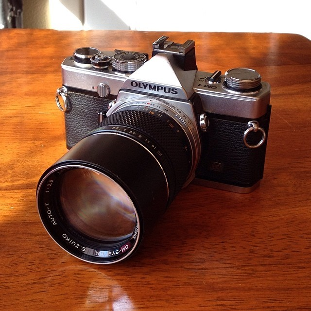 Since I haven't sold this yet I guess I better load a roll and shoot with it. I am gonna take it and do some portraits of a friend today. The 135mm lens is perfect for it.  #film #camera #olympus #on1md #135mm