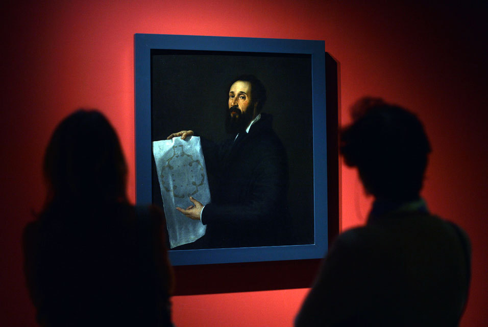 Visitors look at a painting by Renaissance master Titian during a preview of the Tiziano (Titian) exhibition at the Scuderie del Quirinale on March 4, 2013 in Rome.
