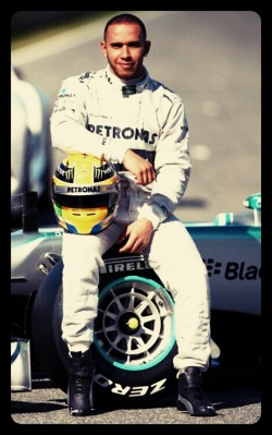 Idk Lewis just looks so much younger in these Mercedes overalls…