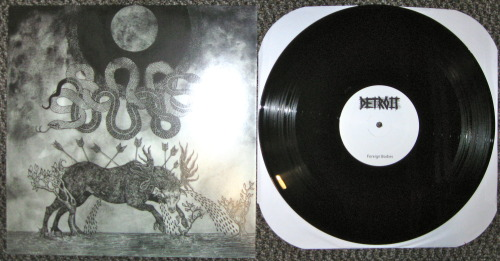 "Robocop/Detroit - ""Dead Language, Foreign Bodies"" split (Give Praise Records 2012) Being a huge fan of Robocop, the great, if not greatest movie about a robotic cop, buying a record by a band called Robocop was a no brainer.  Add the fact that there is another band on the record called Detroit, the city Robocop happens in, and well sheeet, I couldn't give up my money fast enough.   Turns out that the tunes on here are solid as well!  Robocop occupies the a side of this record.  They provide the listener with 6 solid grindcore by ways of brutal hardcore tracks that make stops along experimental electronics town.  I normally don't dig of super clean production in my grindcore, but this side is just right, a perfect blend of thick heavy as fuck guitar tones and clean drums, but the vocals are insane and dirty, which helps keep everything in perspective. Or something. Detroit, who come from somewhere in Canada, are the winners of bringing the mosh on this record.  They play that power violence stuff that seems to be all the rage worldwide right now, and they play it well.  Compared to Robocop's side, this sounds like it was recorded in a closet, there is like no low end on here, probably so the brutal riffs sting your ears that much more. Or something.  Love this shit out of this. -Log."